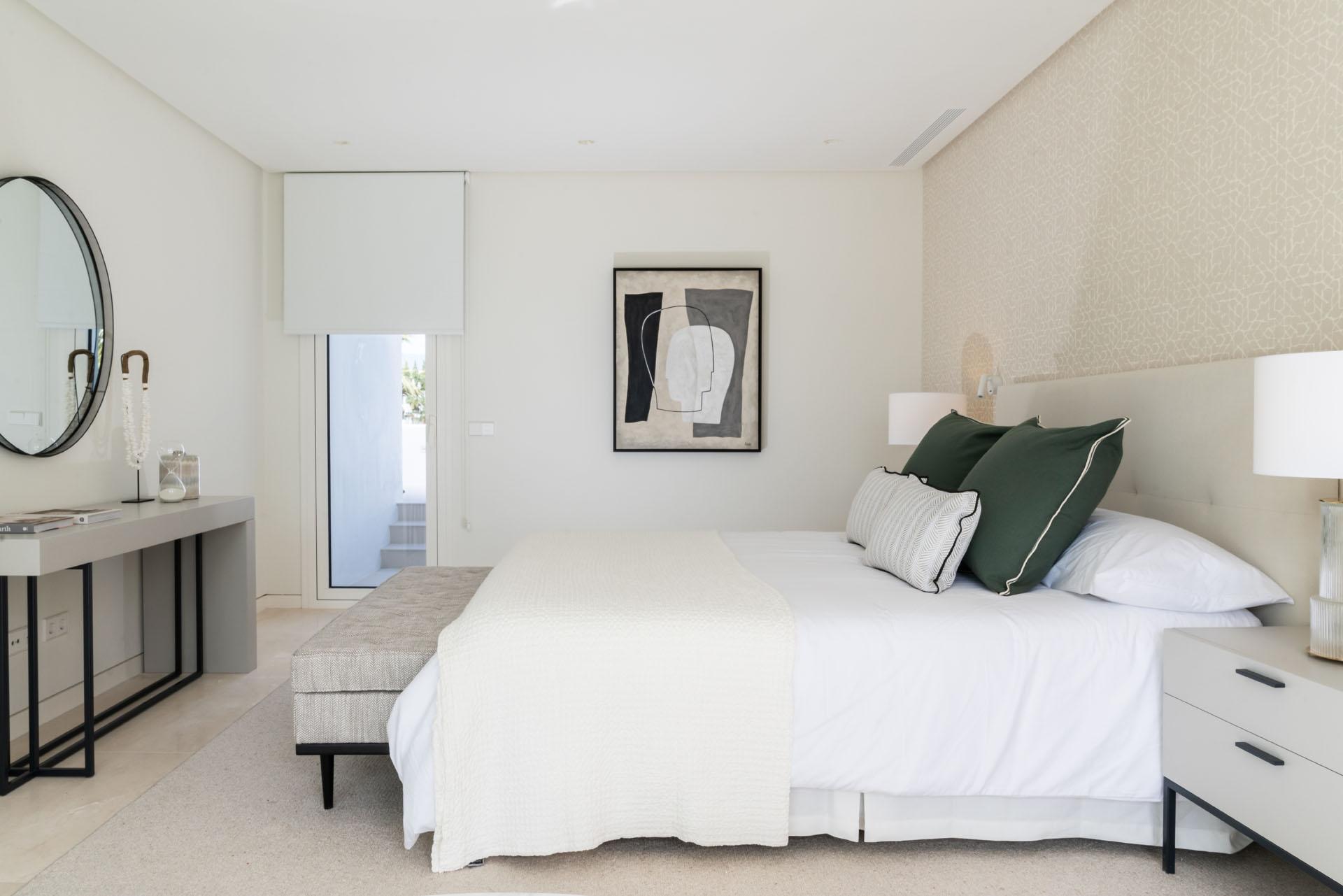 Puente Romano duplex apartment interior design main bedroom